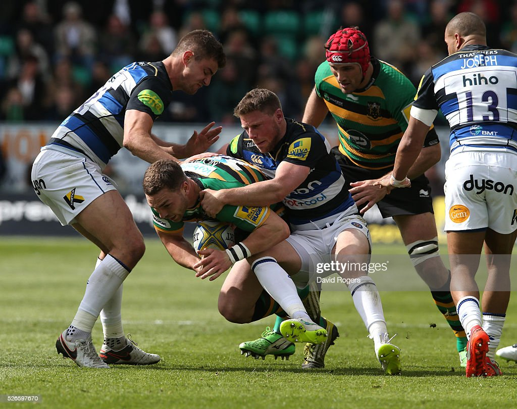 George North of Northampton is tackled by Rhys Priestland (R) during the Aviva Premiership match between Northampton Saints and Bath at Franklin's Gardens on April 30, 2016 in Northampton, England.
