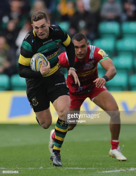 George North of Northampton Saints breaks clear of Joe Marchant during the Aviva Premiership match between Northampton Saints and Harlequins at...