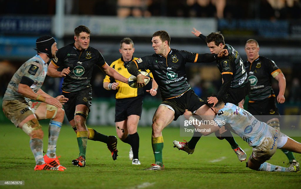 <a gi-track='captionPersonalityLinkClicked' href=/galleries/search?phrase=George+North&family=editorial&specificpeople=7320853 ng-click='$event.stopPropagation()'>George North</a> of Northampton Saints is tackled by Mike Phillips of Racing Metro 92 during the European Rugby Champions Cup match between Northampton Saints and Racing Metro 92 at Franklin's Gardens on January 24, 2015 in Northampton, England.