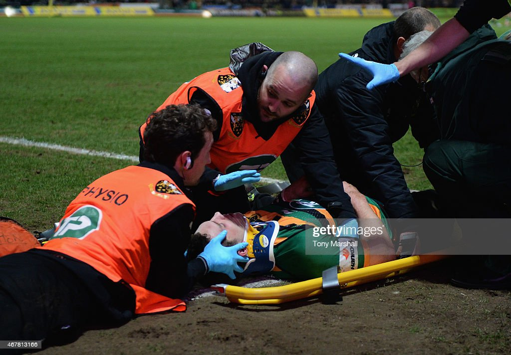 <a gi-track='captionPersonalityLinkClicked' href=/galleries/search?phrase=George+North&family=editorial&specificpeople=7320853 ng-click='$event.stopPropagation()'>George North</a> of Northampton Saints receives treatment after scoring a try and colliding with Nathan Hughes of Wasps during the Aviva Premiership match between Northampton Saints and Wasps at Franklin's Gardens on March 27, 2015 in Northampton, England.