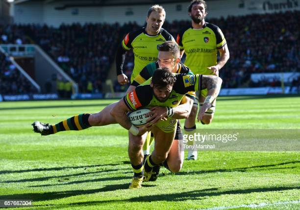 George North of Northampton Saints tackles Adam Thopstone of Leicester Tigers during the Aviva Premiership match between Northampton Saints and...