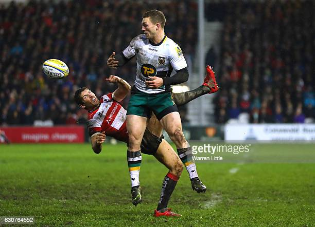 George North of Northampton Saints wins the ball against James Hook of Gloucester Rugby during the Aviva Premiership match between Gloucester Rugby...