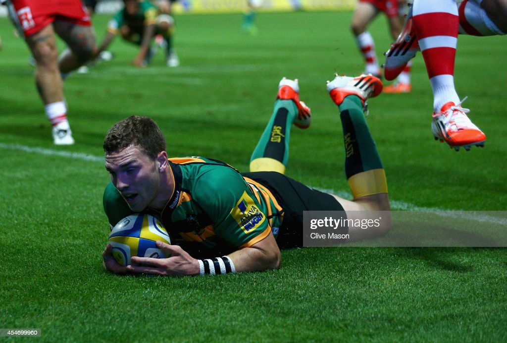 <a gi-track='captionPersonalityLinkClicked' href=/galleries/search?phrase=George+North&family=editorial&specificpeople=7320853 ng-click='$event.stopPropagation()'>George North</a> of Northampton scores a try during the Aviva Premiership match between Northampton Saints and Gloucester Rugby at Franklin's Gardens on September 5, 2014 in Northampton, England.
