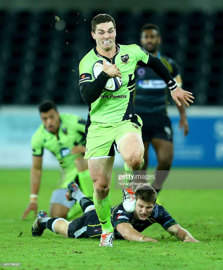 <a gi-track='captionPersonalityLinkClicked' href=/galleries/search?phrase=George+North&family=editorial&specificpeople=7320853 ng-click='$event.stopPropagation()'>George North</a> of Saints breaks away to score the second try during the European Rugby Champions Cup match between Ospreys and Northampton Saints at the Liberty Stadium on January 18, 2015 in Swansea, Wales.