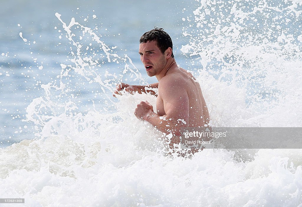 George North of the British & Irish Lions is hit by a wave in the ocean after a training session on July 3, 2013 in Noosa, Australia.