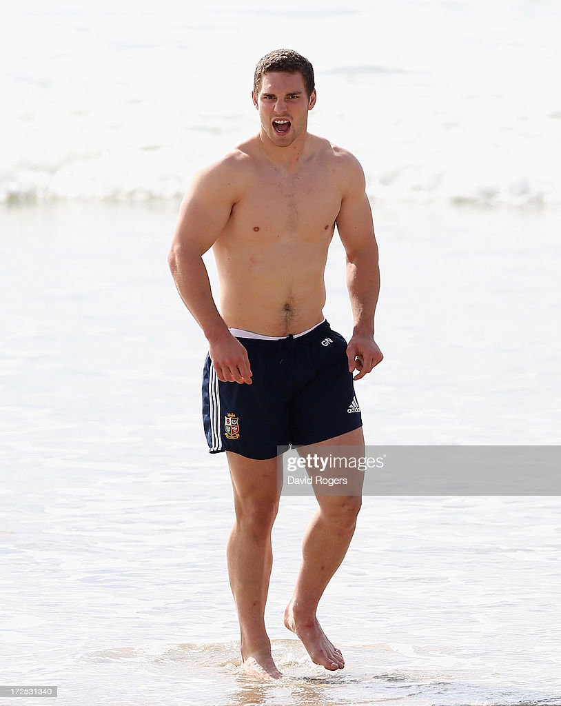 George North of the British & Irish Lions walks up the beach from the ocean after a training session on July 3, 2013 in Noosa, Australia.