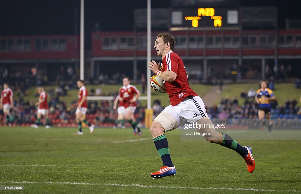 <a gi-track='captionPersonalityLinkClicked' href=/galleries/search?phrase=George+North&family=editorial&specificpeople=7320853 ng-click='$event.stopPropagation()'>George North</a> of the Lions breaks clear for his first try during the match between Combined Country and the British & Irish Lions at Hunter Stadium on June 11, 2013 in Newcastle, Australia.