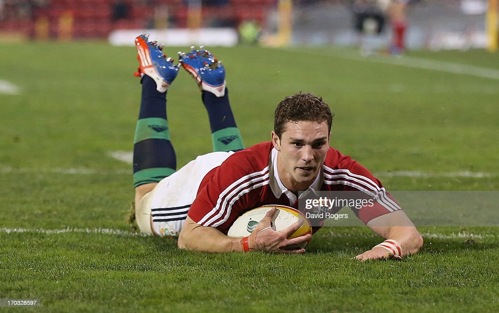 George North of the Lions dives over for his second try during the match between Combined Country and the British & Irish Lions at Hunter Stadium on June 11, 2013 in Newcastle, Australia.