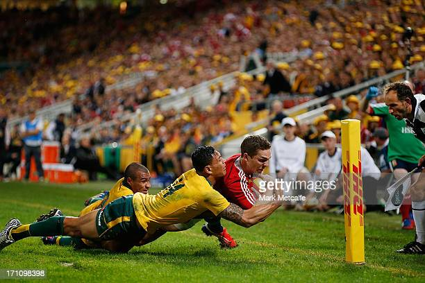 George North of the Lions is tackled by Israel Folau of the Wallabies to prevent a try during the First Test match between the Australian Wallabies...