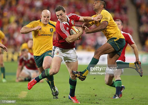 George North of the Lions is tackled by Kurtley Beale during the First Test match between the Australian Wallabies and the British Irish Lions at...