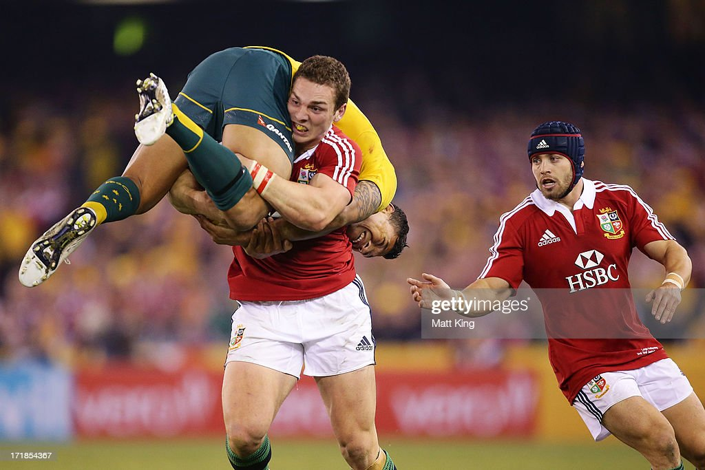 George North of the Lions lifts Israel Folau of Wallabies while carrying the ball as Leigh Halfpenny (R) supports during game two of the International Test Series between the Australian Wallabies and the British & Irish Lions at Etihad Stadium on June 29, 2013 in Melbourne, Australia.
