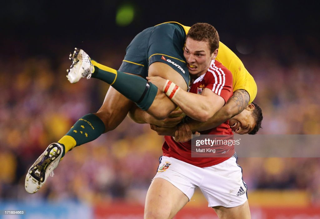 George North of the Lions lifts Israel Folau of Wallabies while carrying the ball during game two of the International Test Series between the Australian Wallabies and the British & Irish Lions at Etihad Stadium on June 29, 2013 in Melbourne, Australia.