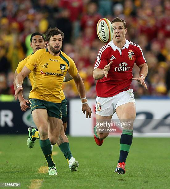 George North of the Lions races for the loose ball with Adam AshleyCooper during the International Test match between the Australian Wallabies and...
