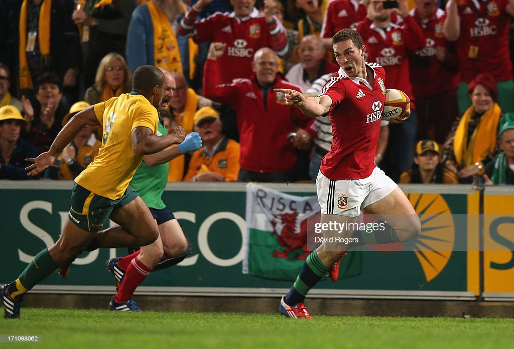 <a gi-track='captionPersonalityLinkClicked' href=/galleries/search?phrase=George+North&family=editorial&specificpeople=7320853 ng-click='$event.stopPropagation()'>George North</a> of the Lions taunts <a gi-track='captionPersonalityLinkClicked' href=/galleries/search?phrase=Will+Genia&family=editorial&specificpeople=4110822 ng-click='$event.stopPropagation()'>Will Genia</a> as he breaks clear to score the first Lions try during the First Test match between the Australian Wallabies and the British & Irish Lions at Suncorp Stadium on June 22, 2013 in Brisbane, Australia.