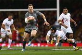 George North of Wales breaks clear from the challenge of Latiume Fosita of Tonga during the International match between Wales and Tonga at the...