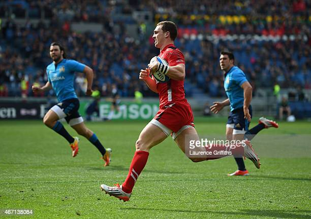 George North of Wales breaks on the way to scoring his first try during the RBS Six Nations match between Italy and Wales at Stadio Olimpico on March...