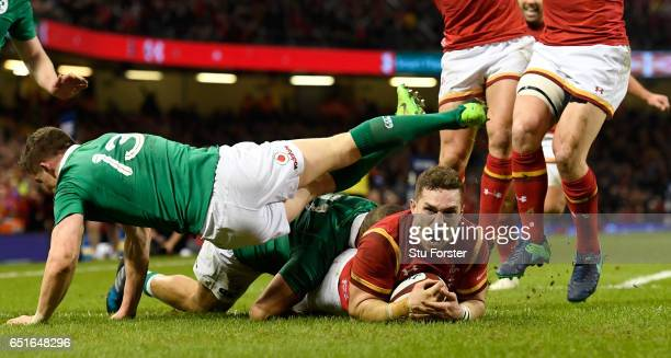 George North of Wales celebrates after scoring their first try during the Six Nations match between Wales and Ireland at the Principality Stadium on...