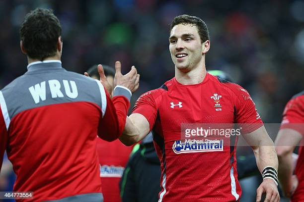 George North of Wales celebrates with Mike Phillips after their 2013 victory during the RBS Six Nations match between France and Wales at the Stade...