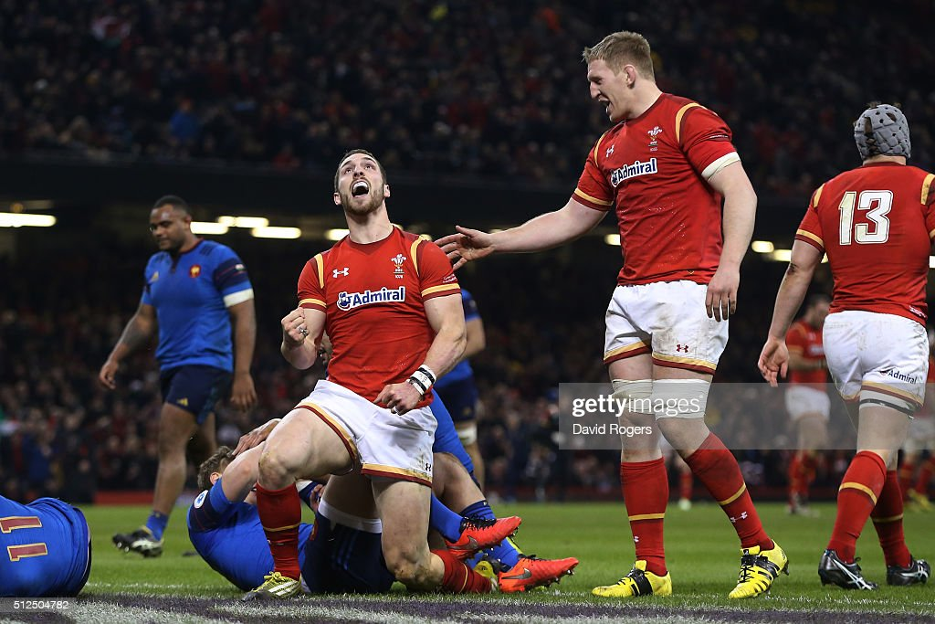 <a gi-track='captionPersonalityLinkClicked' href=/galleries/search?phrase=George+North&family=editorial&specificpeople=7320853 ng-click='$event.stopPropagation()'>George North</a> of Wales celebrates with teammate <a gi-track='captionPersonalityLinkClicked' href=/galleries/search?phrase=Bradley+Davies&family=editorial&specificpeople=677663 ng-click='$event.stopPropagation()'>Bradley Davies</a> (R) after scoring the opening try during the RBS Six Nations match between Wales and France at the Principality Stadium on February 26, 2016 in Cardiff, Wales.
