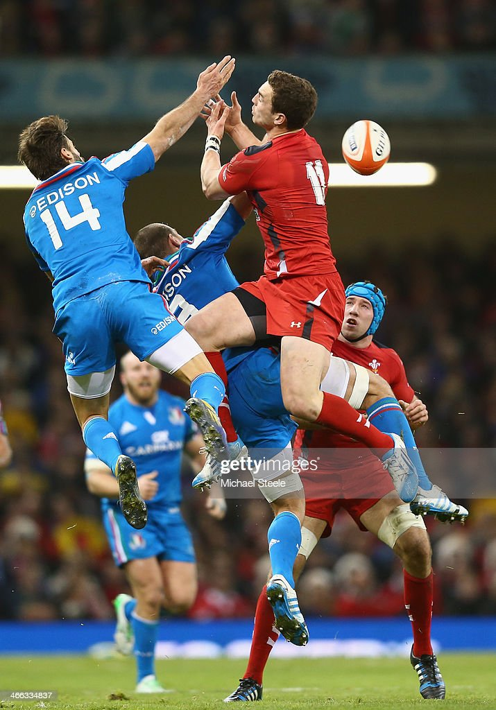 George North of Wales challenges for a high ball alongside Angelo Esposito and Sergio Parisse of Italy during the RBS Six Nations match between Wales...