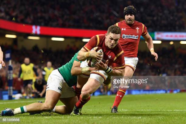 George North of Wales crashes through the Ireland defence to score the opening try during the Six Nations match between Wales and Ireland at the...