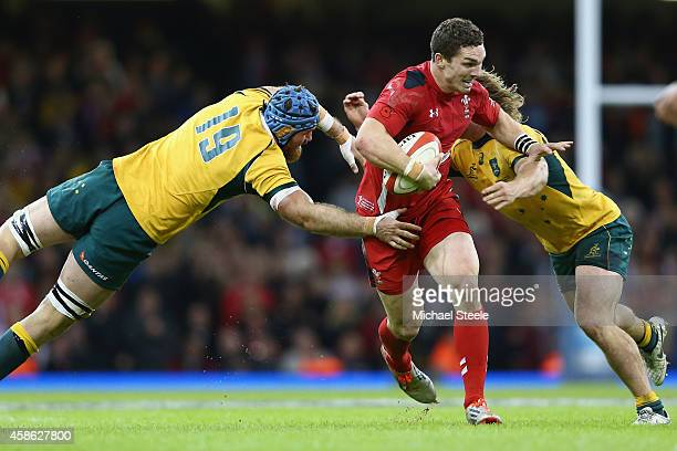 George North of Wales cuts between James Horwill and Michael Hooper of Australia during the International match between Wales and Australia at the...