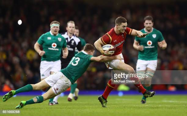 George North of Wales evades a tackle by Garry Ringrose of Ireland during the Six Nations match between Wales and Ireland at the Principality Stadium...