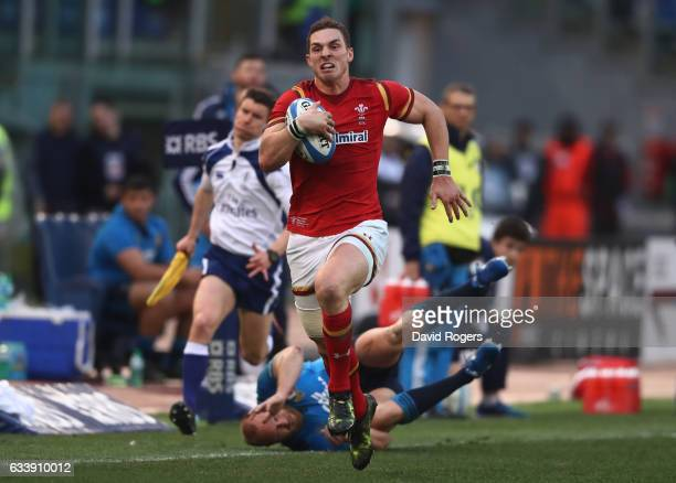 George North of Wales evades the attempted tackle from Leonardo Ghiraldini of Italy enroute to scoring his team's third try during the RBS Six...