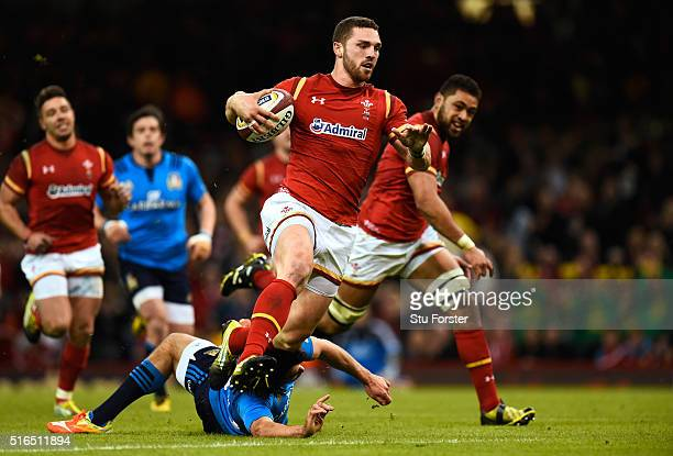 George North of Wales evades the tackle from Luke McLean of Italy to run in his team's fifth try during the RBS Six Nations match between Wales and...