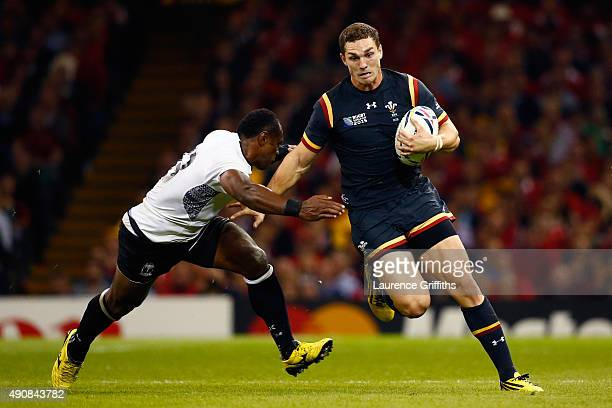George North of Wales holds off Vereniki Goneva of Fiji during the 2015 Rugby World Cup Pool A match between Wales and Fiji at the Millennium Stadium...