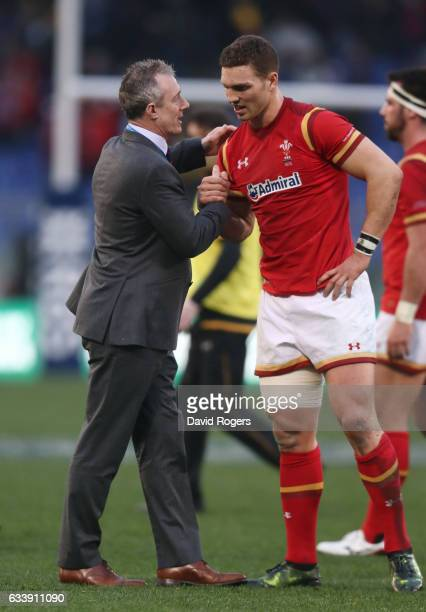 George North of Wales is congratulated by Rob Howley the Wales interim head coach following their team's 337 victory during the RBS Six Nations match...