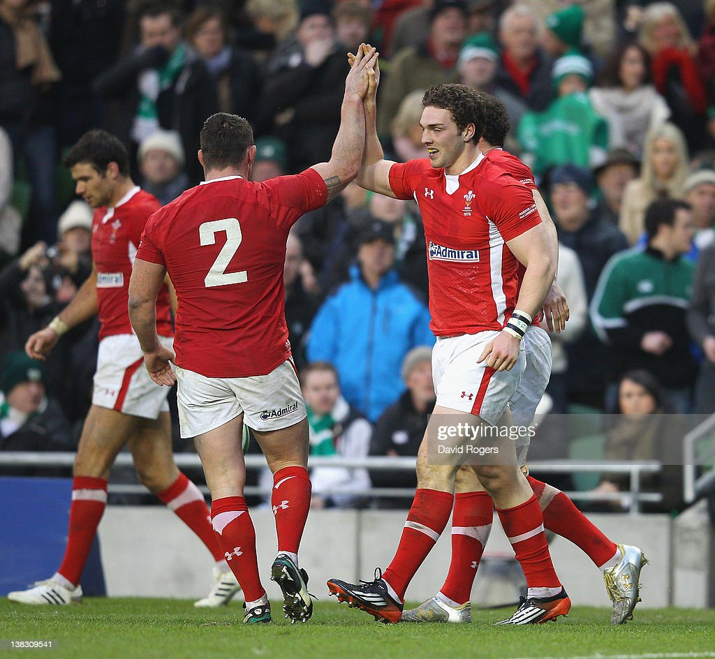 <a gi-track='captionPersonalityLinkClicked' href=/galleries/search?phrase=George+North&family=editorial&specificpeople=7320853 ng-click='$event.stopPropagation()'>George North</a> of Wales (R) is congratulated by team mate <a gi-track='captionPersonalityLinkClicked' href=/galleries/search?phrase=Huw+Bennett&family=editorial&specificpeople=562196 ng-click='$event.stopPropagation()'>Huw Bennett</a> after scoring a try during the RBS Six Nations match between Ireland and Wales at the Aviva Stadium on February 5, 2012 in Dublin, Ireland