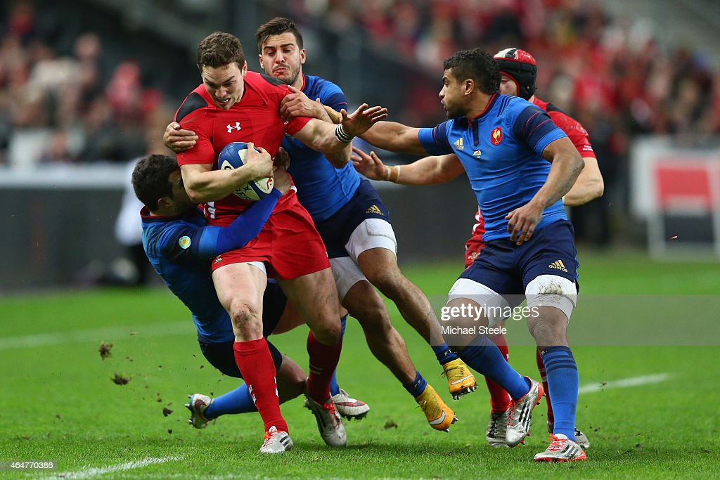 George North of Wales is halted by Brice Dulin (L) and Sofiane Guitoune of France as Wesley Fofana (R) closes in during the RBS Six Nations match between France and Wales at the Stade de France on February 28, 2015 in Paris, France.