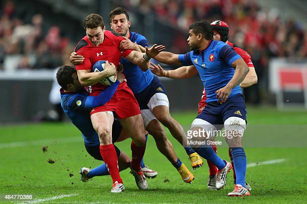 George North of Wales is halted by Brice Dulin and Sofiane Guitoune of France as Wesley Fofana closes in during the RBS Six Nations match between...