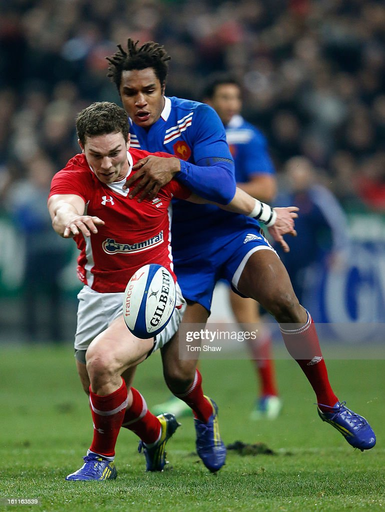 George North of Wales is tackled by Benjamin Fall of France during the RBS Six Nations match between France and Wales at Stade de France on February 9, 2013 in Paris, France.