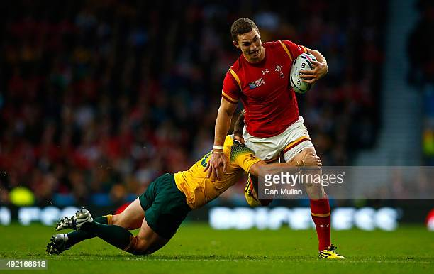 George North of Wales is tackled by Bernard Foley of Australia during the 2015 Rugby World Cup Pool A match between Australia and Wales at Twickenham...