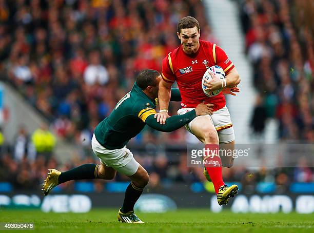 George North of Wales is tackled by Bryan Habana of South Africa during the 2015 Rugby World Cup Quarter Final match between South Africa and Wales...