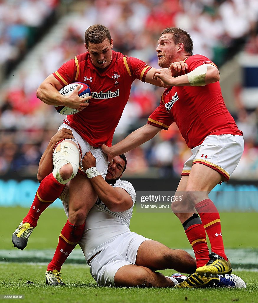 <a gi-track='captionPersonalityLinkClicked' href=/galleries/search?phrase=George+North&family=editorial&specificpeople=7320853 ng-click='$event.stopPropagation()'>George North</a> of Wales is tackled by Ellis Genge of England during an International Friendly match between England and Wales at Twickenham Stadium on May 29, 2016 in London, England.