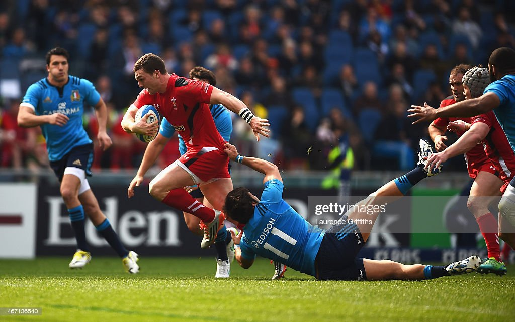 <a gi-track='captionPersonalityLinkClicked' href=/galleries/search?phrase=George+North&family=editorial&specificpeople=7320853 ng-click='$event.stopPropagation()'>George North</a> of Wales is tackled by <a gi-track='captionPersonalityLinkClicked' href=/galleries/search?phrase=Giovanbattista+Venditti&family=editorial&specificpeople=5040878 ng-click='$event.stopPropagation()'>Giovanbattista Venditti</a> of Italy during the RBS 6 Nations match between Italy and Wales at Stadio Olimpico on March 21, 2015 in Rome, Italy.