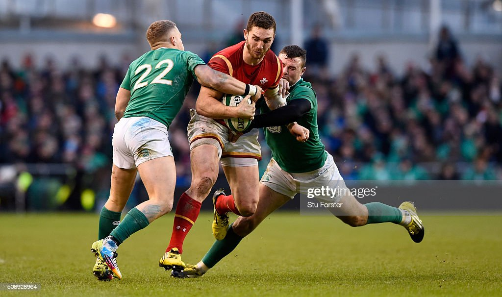 <a gi-track='captionPersonalityLinkClicked' href=/galleries/search?phrase=George+North&family=editorial&specificpeople=7320853 ng-click='$event.stopPropagation()'>George North</a> of Wales is tackled by Ian Madigan (l) and Robbie Henshaw of Ireland during the RBS Six Nations match between Ireland and Wales at the Aviva Stadium at Aviva Stadium on February 7, 2016 in Dublin, Ireland.