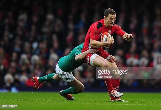 George North of Wales is tackled by Johnny Sexton of Ireland during the RBS Six Nations match between Wales and Ireland at Millennium Stadium on...