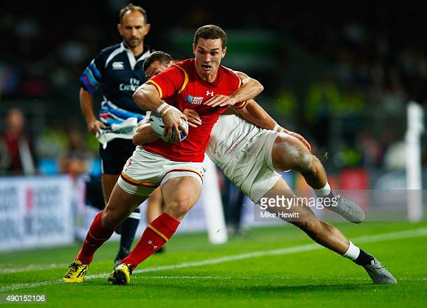 George North of Wales is tackled by Jonny May of England during the 2015 Rugby World Cup Pool A match between England and Wales at Twickenham Stadium...