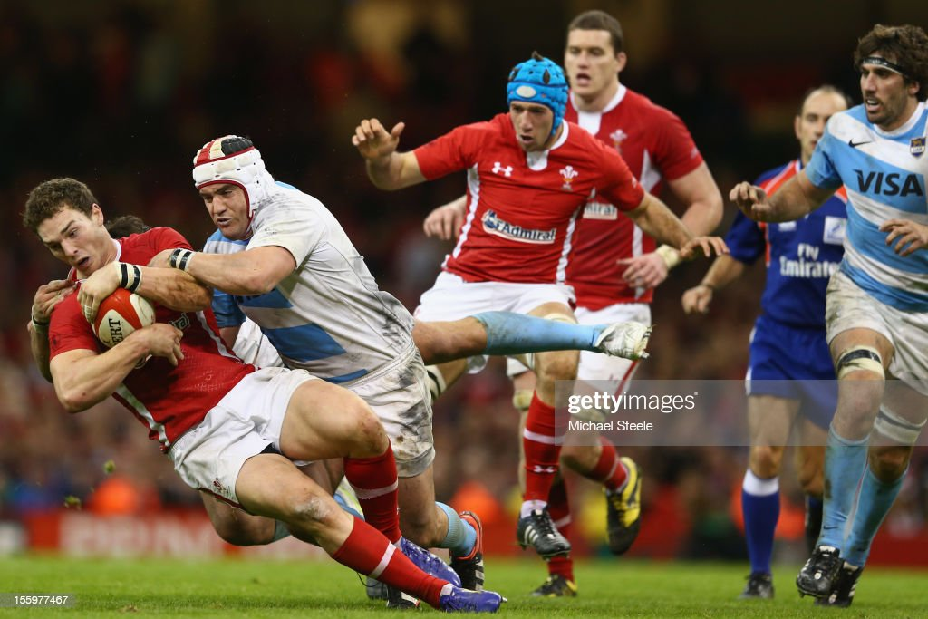 <a gi-track='captionPersonalityLinkClicked' href=/galleries/search?phrase=George+North&family=editorial&specificpeople=7320853 ng-click='$event.stopPropagation()'>George North</a> (L) of Wales is tackled by <a gi-track='captionPersonalityLinkClicked' href=/galleries/search?phrase=Marcos+Ayerza&family=editorial&specificpeople=3034035 ng-click='$event.stopPropagation()'>Marcos Ayerza</a> (2L) of Argentina during the Wales versus Argentina International match at the Millennium Stadium on November 10, 2012 in Cardiff, Wales.