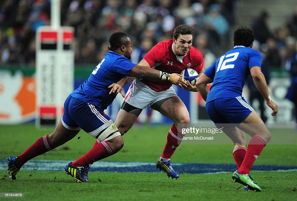 George North of Wales is tackled by Mathieu Bastareaud of France during the RBS Six Nations match between France and Wales at Stade de France on February 9, 2013 in Paris, France.