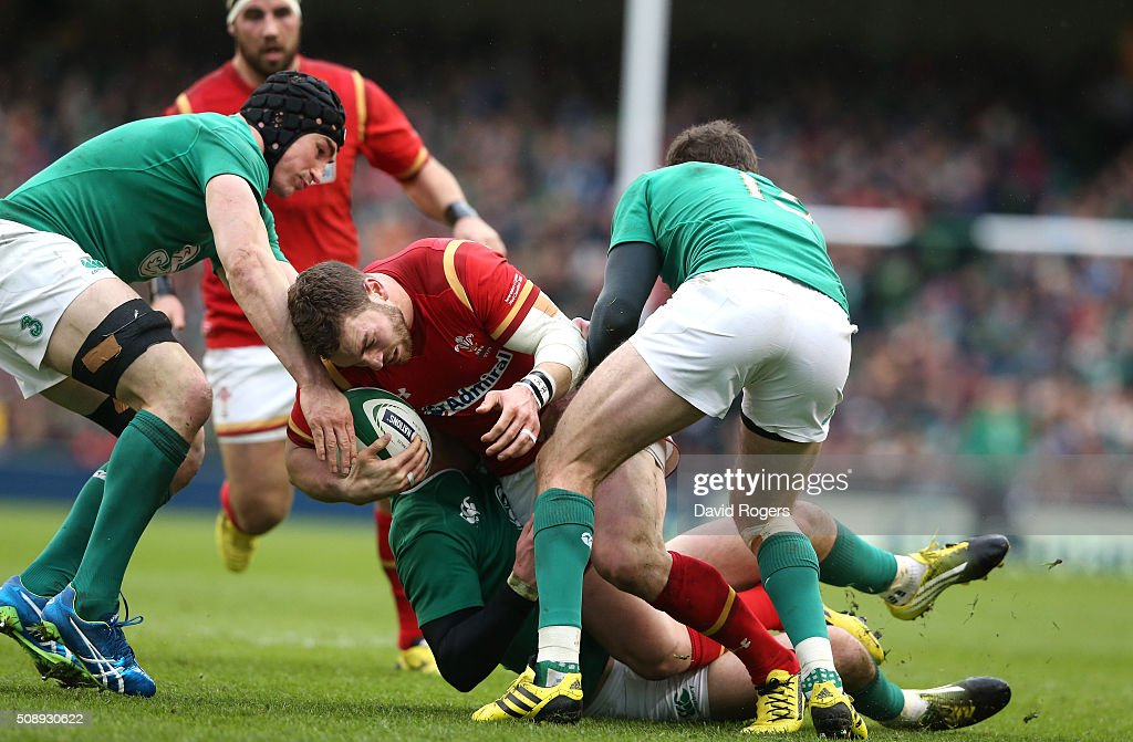 <a gi-track='captionPersonalityLinkClicked' href=/galleries/search?phrase=George+North&family=editorial&specificpeople=7320853 ng-click='$event.stopPropagation()'>George North</a> of Wales is tackled during the RBS Six Nations match between Ireland and Wales at the Aviva Stadium on February 7, 2016 in Dublin, Ireland.