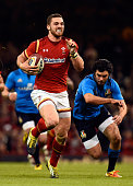 George North of Wales races away from Luke McLean to score during the RBS Six Nations match between Wales and Italy at the Principality Stadium on...