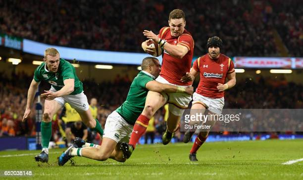 George North of Wales scores the first try during the Six Nations match between Wales and Ireland at the Principality Stadium on March 10 2017 in...