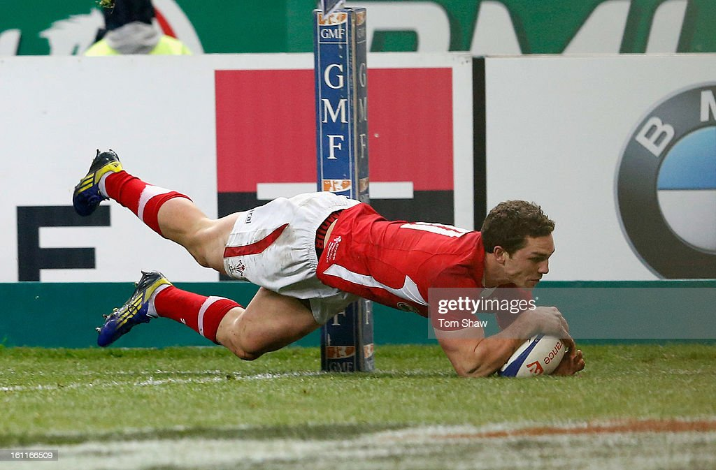 <a gi-track='captionPersonalityLinkClicked' href=/galleries/search?phrase=George+North&family=editorial&specificpeople=7320853 ng-click='$event.stopPropagation()'>George North</a> of Wales scores the opening try during the RBS Six Nations match between France and Wales at Stade de France on February 9, 2013 in Paris, France.