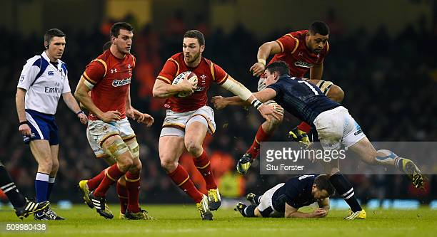 George North of Wales sets off on a mazey run to score his team's third try during the RBS Six Nations match between Wales and Scotland at the...