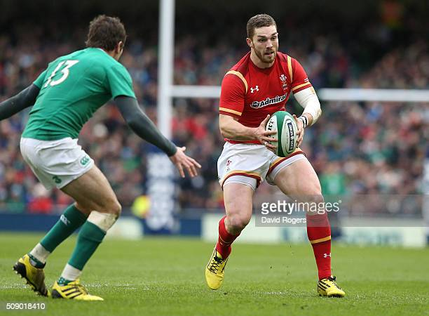 George North of Wales takes on Jared Payne during the RBS Six Nations match between Ireland and Wales at the Aviva Stadium on February 7 2016 in...